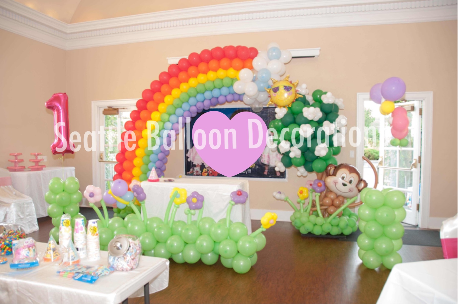 Rainbow and blossom arch for 1st birthday party seattle for Balloon decoration for 1st birthday party